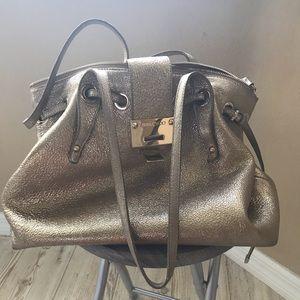 Authentic Choo gold purse.